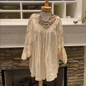 Silk Ruffled shirt.
